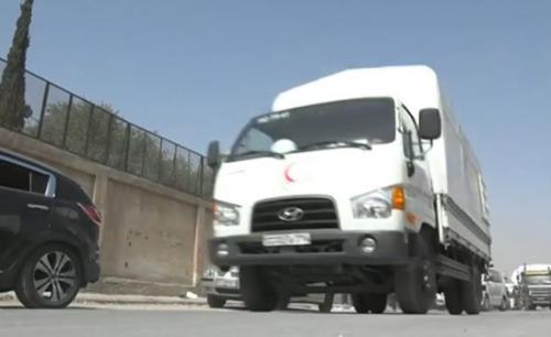 المساعدات الإنسانية تصل سكان الغوطة الشرقية رغم الغارات الجوية