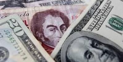 فنزويلا تلغي استخدام الدولار الأمريكي.. تفاصيل