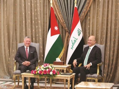 العاهل الأردني يبحث مع الرئيس العراقي دعم العلاقات بين البلدين