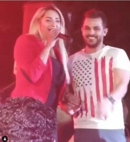 مي حلمي بصحبة زوجها محمد رشاد بحفله في النادي الأهلي (فيديو)