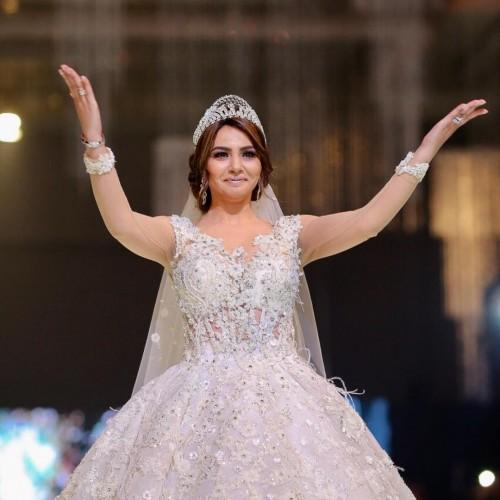 دينا فؤاد تنشر صورها بفستان الزفاف