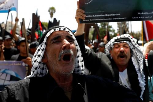 بالإضراب الشامل والمسيرات.. فلسطينيون يحيون ذكرى النكبة (صور)