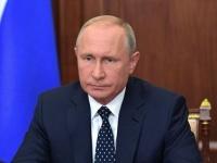 الرئيس الروسي يبحث مع ميركل وماكرون الأزمة الأوكرانية الداخلية