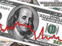 الدولار يهبط لأدنى مستوياته بفعل تراجع عوائد السندات الأمريكية