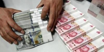 الدولار يهوي مجدداً بفعل تعافي الأسواق والبيانات الصينية