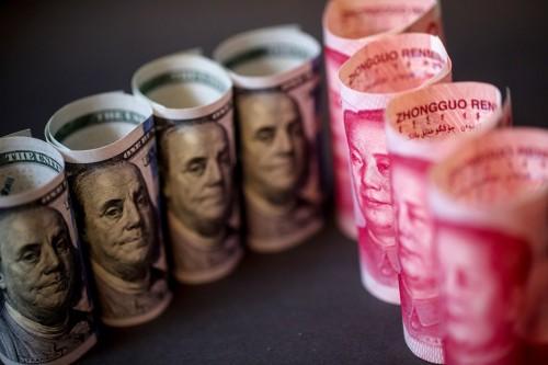 حرب عملات مشتعلة بين الصين وأمريكا.. وخبراء يحذرون من مخاطرها