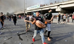 اشتباكات بالأسلحة النارية بين محتجين عراقيين والشرطة بمدينة الناصرية