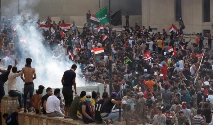 لقطة من احتجاجات العراق تدخل ضمن أفضل 6 لقطات مصورة بالعالم