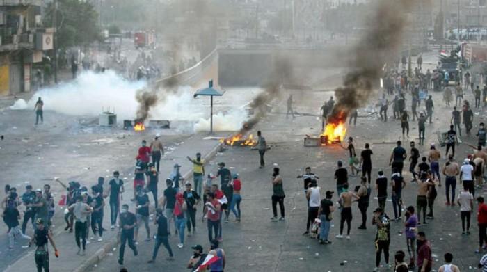 شاهد.. مليشيات إيران تستخدم الأسلحة الثقيلة لقمع متظاهري العراق