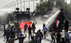 مقتل شخصين وإصابة 100 آخرين فى اشتباكات مع قوات الأمن فى العراق