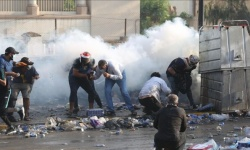 مقتل 3 متظاهرين عراقيين بقنابل غاز الأمن وسط بغداد