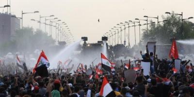 المتظاهرون في العراق يستعيدون التمركز عند جسر الأحرار ببغداد