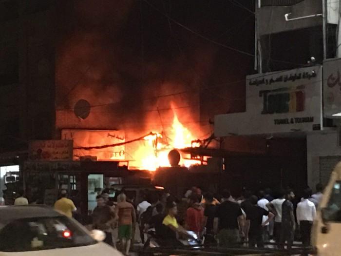 حريق هائل بمبنى وسط بغداد.. والدفاع المدني يسيطر