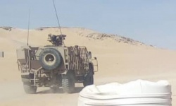 قوة عسكرية من التحالف تصل إلى معسكر العلم شرق عتق