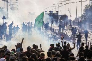 مقتل متظاهر وإصابة 25 في اشتباكات مع الأمن بالعراق
