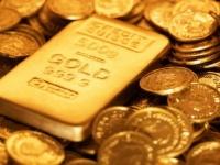 الذهب يتراجع إلى 1606.62 دولار للأوقية