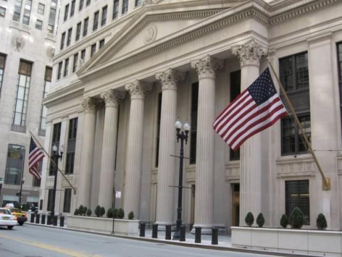 كورونا تجبر المركزي الأمريكي على تخفيض أسعار الفائدة