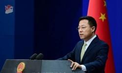 الصين تتبرأ من فيروس كورونا