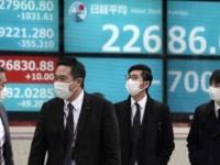 """""""نيكي"""" يتراجع 0.8 %.. ارتفاع موجة الإصابات بكورونا تهبط بأسهم بورصة اليابان"""