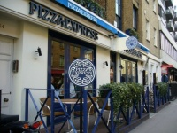 فيروس كورونا يجبر بيتزا إكسبريس في المملكة المتحدة على التقشف