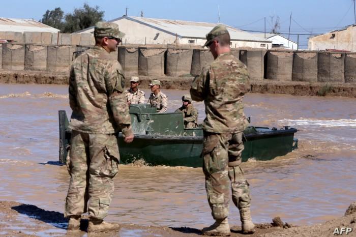 التحالف الدولي يُسلم معسكر التاجي والمعدات للقوات العراقية