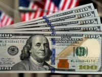 الدولار يهبط أمام العملة الأوروبية ويرتفع مقابل الين