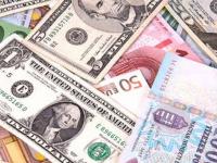 تراجع الدولار الأمريكي عالمياً بعد بيانات اقتصادية