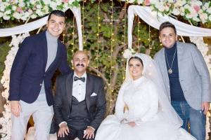 محمد أنور يهنئ محمد توب بزواجه (صورة)