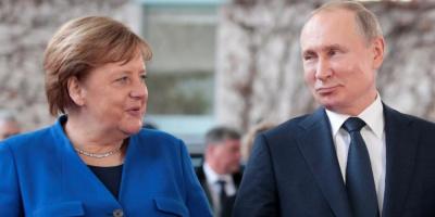 ميركل تطالب بوتين بسحب القوات الروسية من الحدود الأوكرانية