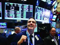 ارتفاع الأسهم الأمريكية وسط تقلبات سوق العملات المشفرة